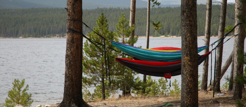 A hammock is one of the most fun things to bring camping for relaxation.