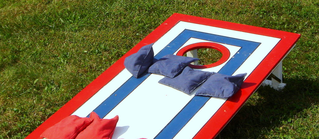 One of the fun camping camping games for families is portable cornhole!