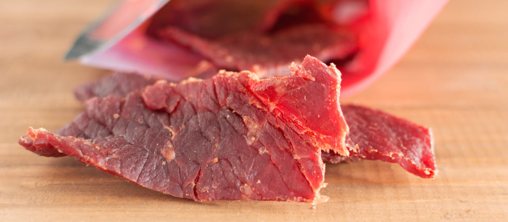 Beef jerky is one of the best camping snacks to buy thanks to it's compact size & great taste.