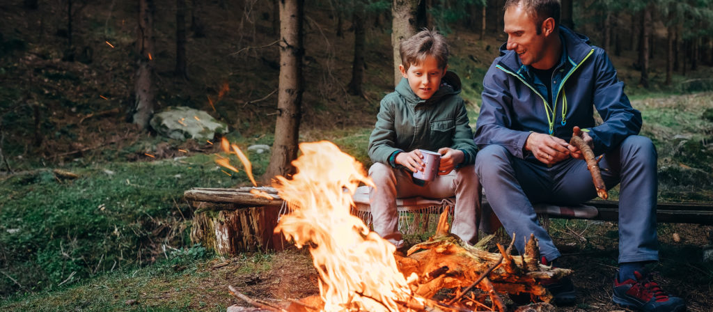 A bonfire provides a nice bonding experience between family members.