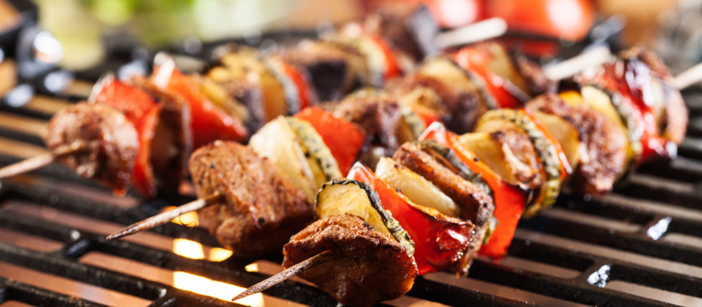 Skewers are one of the east camping meals for large group.
