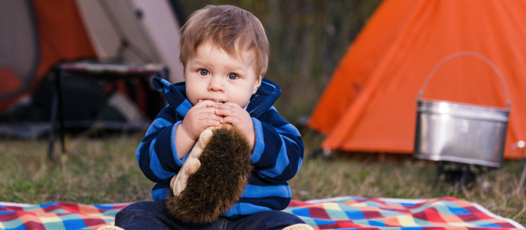 Give your toddler a safe and clean space to play on a camping bed.