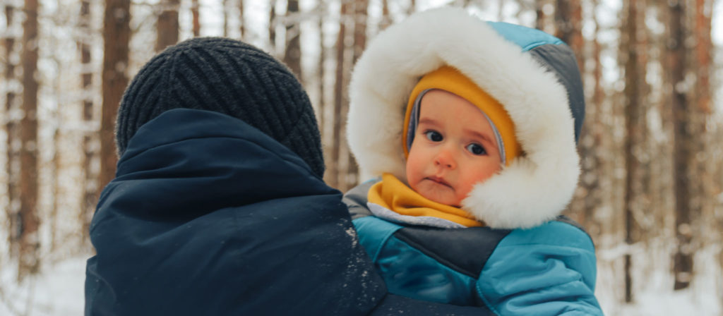 Warm clothing is absolutely essential when camping with a baby in cold weather.