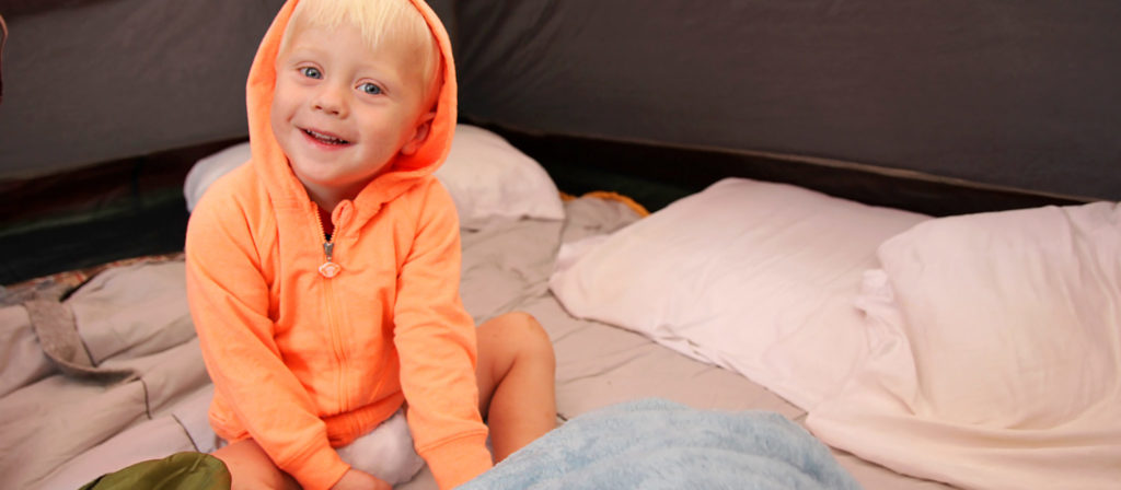 Sleeping in a tent with your baby is best when they have their own little sleeping bag.