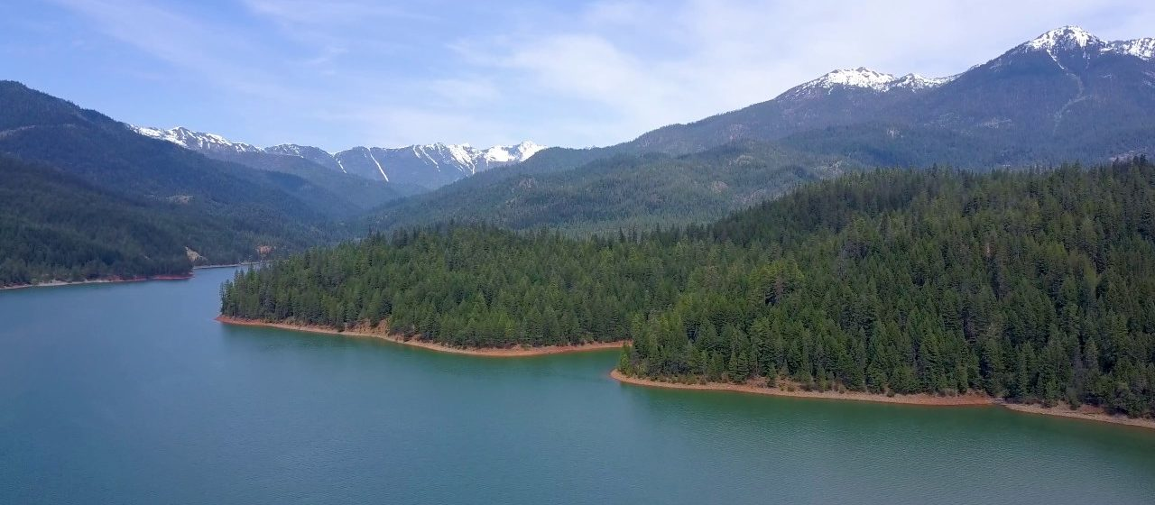 You could experience a view like this firsthand by visiting the pristine Trinity Lake in northern California.