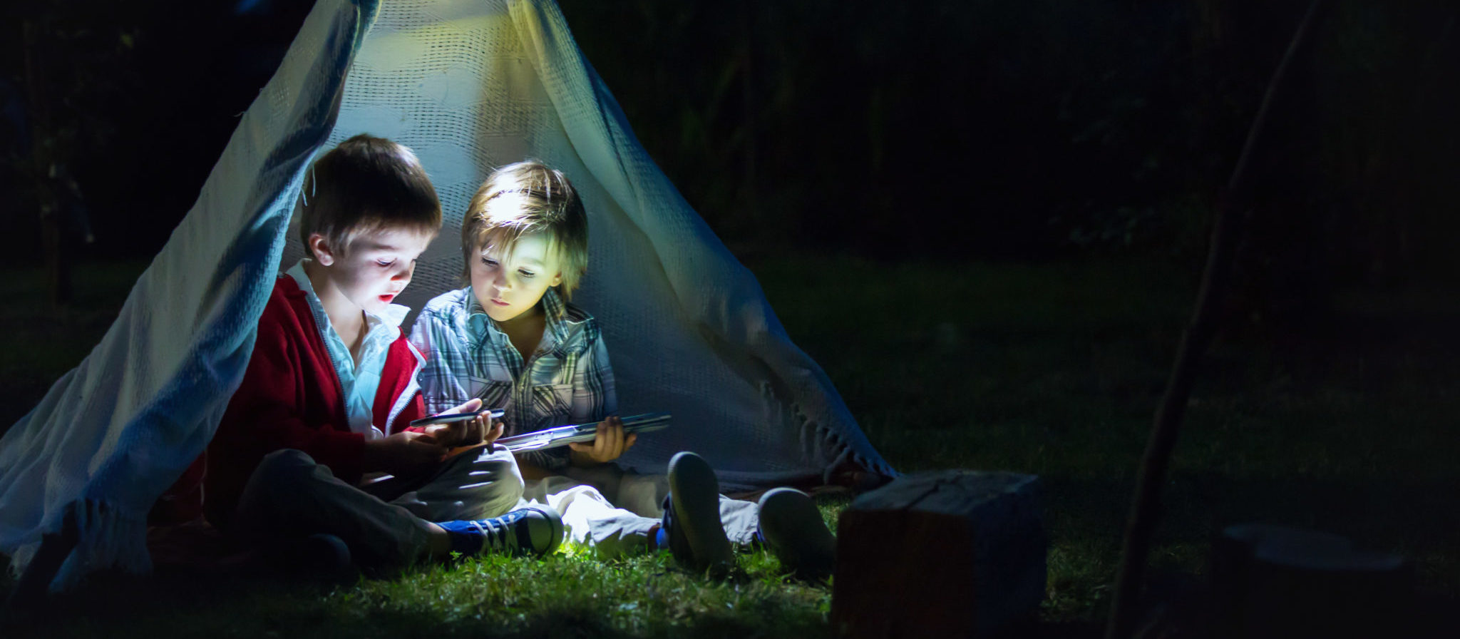 Telling stories, scary or otherwise, is a great way for kids to pass the time on a camping trip. Be ready, though... You might need to get them started!